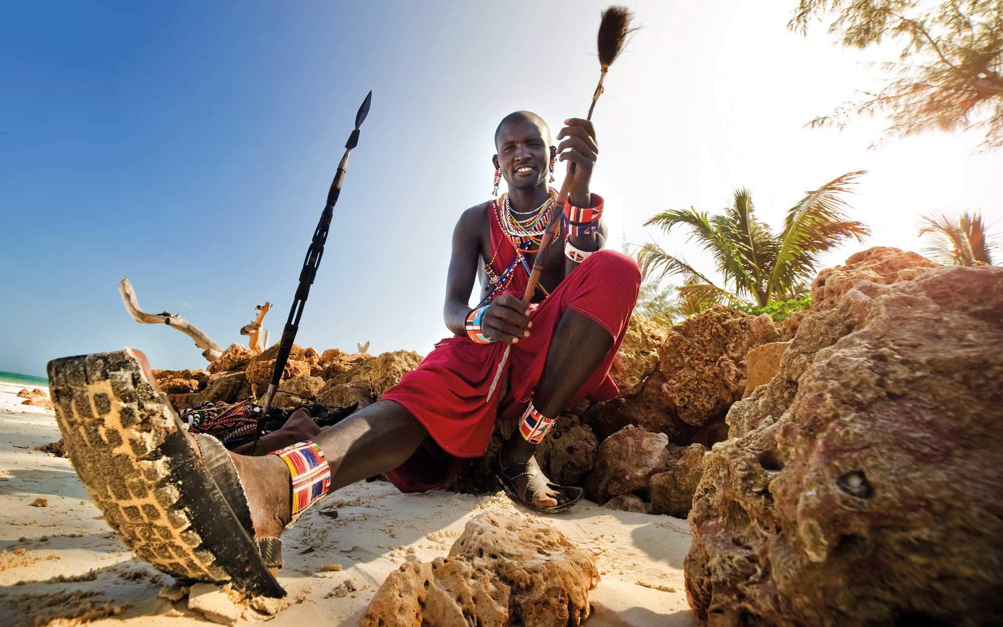 adventure travel branding refresh hero image maasai warrior explore worldwide
