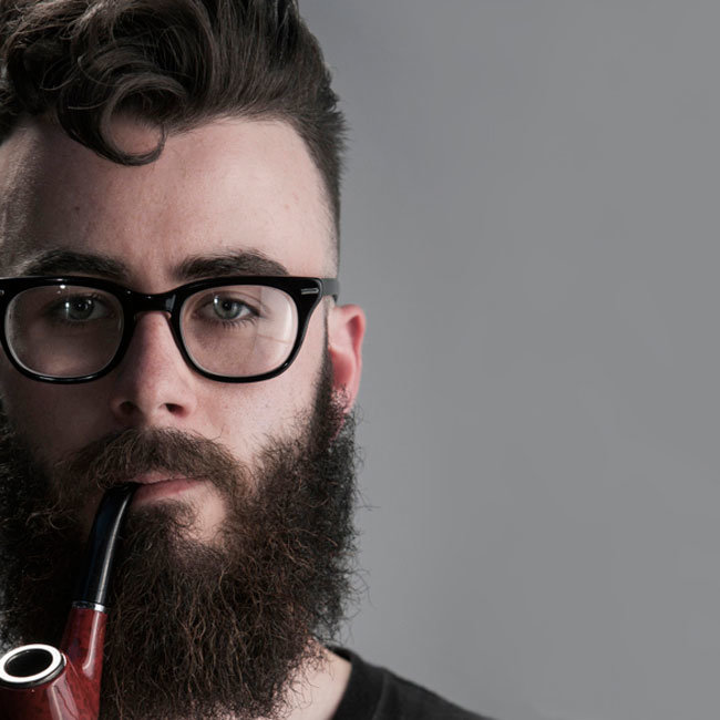 Man wearing pipe and glass