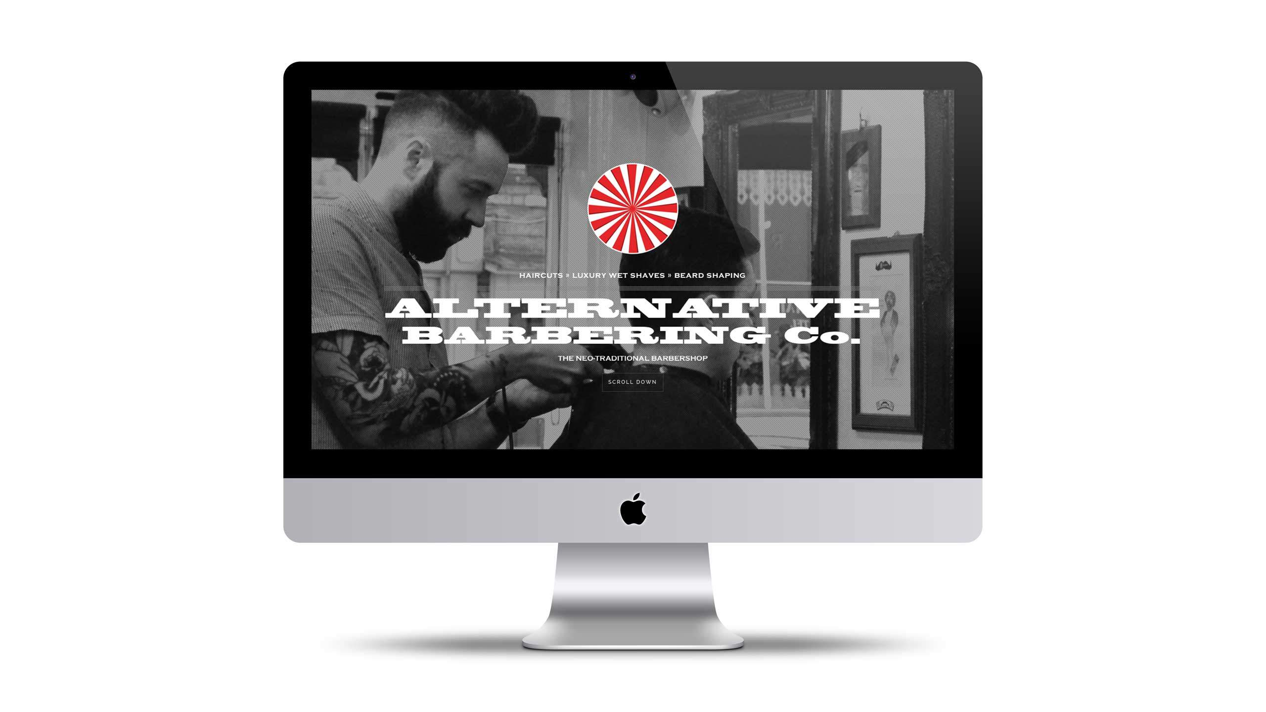 Barbershop website design on iMac home page