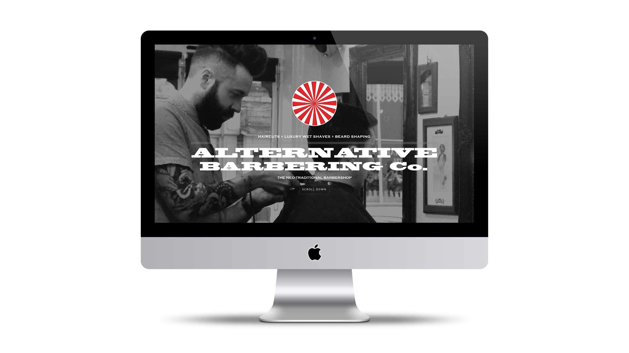 Barbershop website design on iMac home page