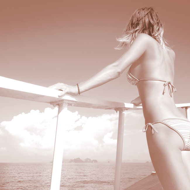Red Sea Hotels brochure- girl on boat