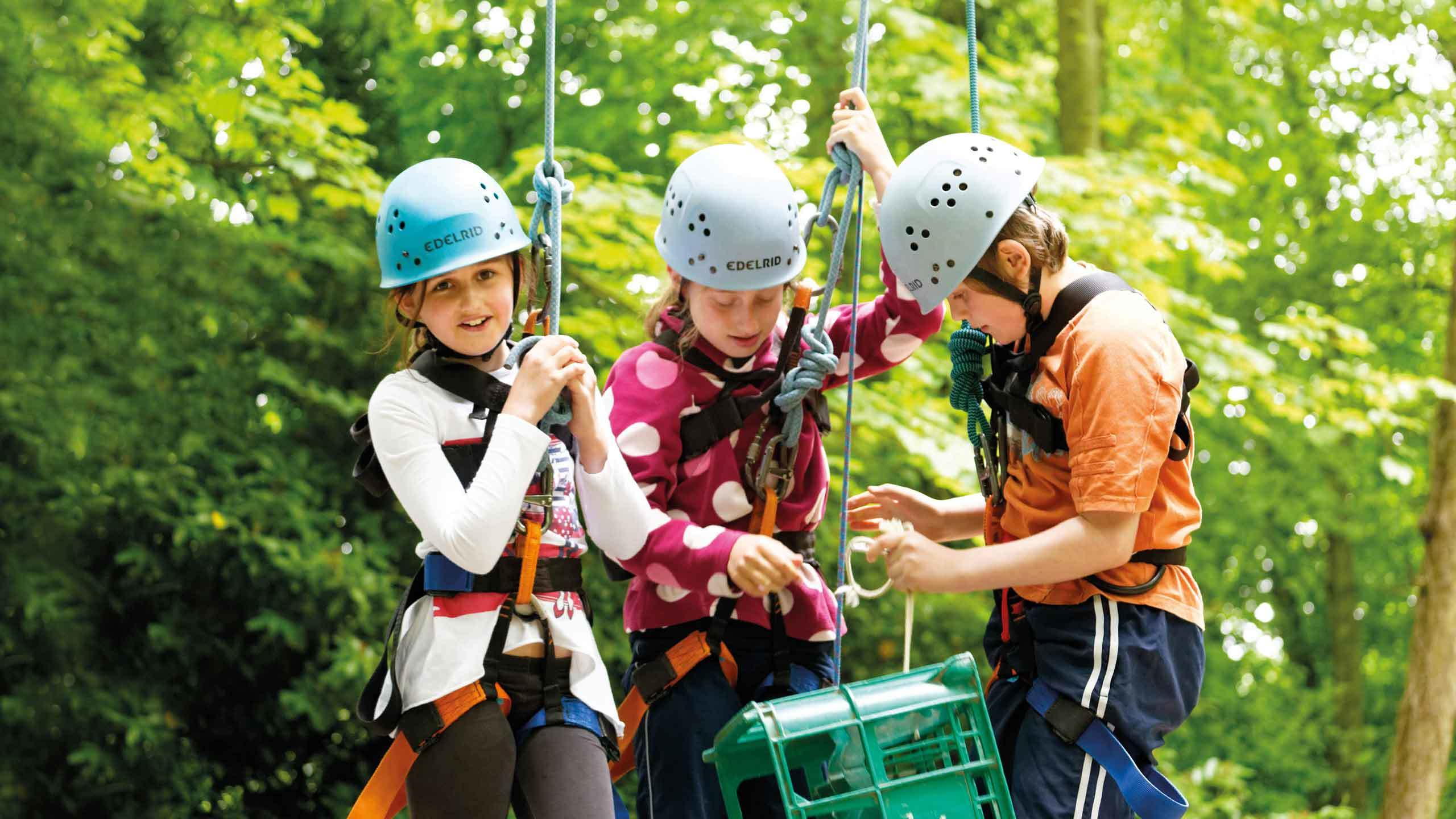 school adventure branding hero image girls climbing pgl travel
