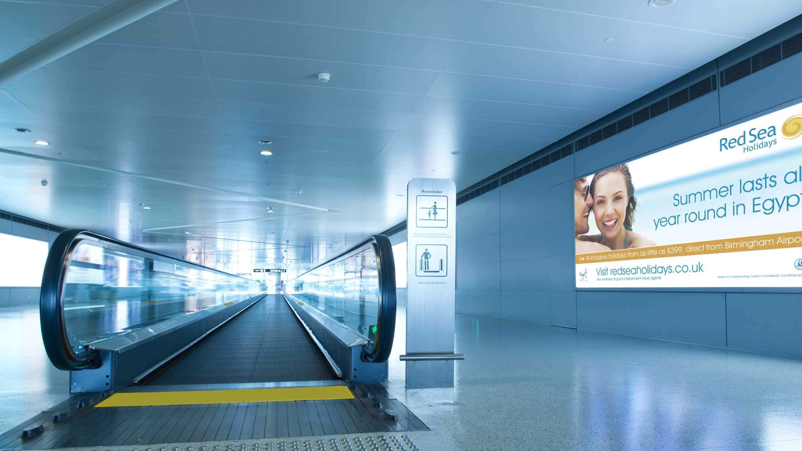 tour operator branding airport advert travelator couple red sea holidays